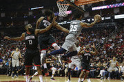 Derrick Rose #25 of the Minnesota Timberwolves passes the ball under the basket against Nene Hilario #42 of the Houston Rockets and James Harden #13 in the second half during Game One of the first round of the 2018 NBA Playoffs at Toyota Center on April 15, 2018 in Houston, Texas.  NOTE TO USER: User expressly acknowledges and agrees that, by downloading and or using this photograph, User is consenting to the terms and conditions of the Getty Images License Agreement.