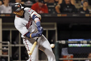 Nelson Cruz #23 of the Minnesota Twins hits a solo home run during the seventh inning of a game against the Chicago White Sox at Guaranteed Rate Field on July 26, 2019 in Chicago, Illinois.