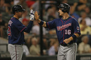 Josh Willingham #16 of the Minnesota Twins is congratulated by Trevor Plouffe #24 after scoring a run in the 5th inning against the Chicago White Sox at U.S. Cellular Field on September 4, 2012 in Chicago, Illinois.