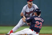 Logan Forsythe #24 of the Minnesota Twins forces out Michael Brantley #23 of the Cleveland Indians at second base during the first inning at Progressive Field on August 7, 2018 in Cleveland, Ohio.