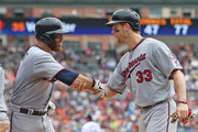 Ryan Doumit #9 of the Minnesota Twins is congratulated by teammate Justin Morneau #33 after hitting a three-run home run in the fifth inning of the game against the Detroit Tigers at Comerica Park on August 22, 2013 in Detroit, Michigan.