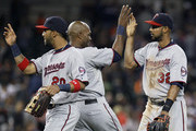 Eddie Rosario #20 of the Minnesota Twins celebrates along with  Torii Hunter #48 of the Minnesota Twins and  Aaron Hicks #32 of the Minnesota Twins after a 6-2 win over the Detroit Tigers at Comerica Park on September 26, 2015 in Detroit, Michigan.