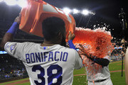 Salvador Perez #13 of the Kansas City Royals is doused with Gatorade by Jorge Bonifacio #38 as they celebrate a 6-4 win agains the Minnesota Twins at Kauffman Stadium on September 13, 2018 in Kansas City, Missouri.