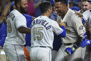 Salvador Perez #13 of the Kansas City Royals celebrates with Whit Merrifield #15 and Jorge Bonifacio #38 as he celebrates his walk-off grand slam against the Minnesota Twins in the ninth inning at Kauffman Stadium on September 14, 2018 in Kansas City, Missouri. The Royals won 8-4.