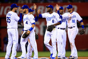 Eric Hosmer #35, Alex Gordon #4, Lorenzo Cain #6, and Paulo Orlando #16 of the Kansas City Royals celebrate after the Royals defeated the Minnesota Twins 6-5 to win the game at Kauffman Stadium on April 21, 2015 in Kansas City, Missouri.