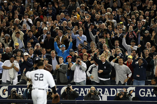 Starting pitcher CC Sabathia #52 of the New York Yankees gets a standing ovation from the crowd after being pulled out of the game in the seventh inning against the Minnesota Twins in Game One of the ALDS during the 2009 MLB Playoffs at Yankee Stadium on October 7, 2009 in the Bronx borough of New York City.