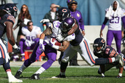 Matt Asiata #44 of the Minnesota Vikings is hit by Sam Acho #49 of the Chicago Bears in the first quarter at Soldier Field on November 1, 2015 in Chicago, Illinois.