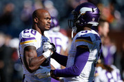 Adrian Peterson #28 and quarterback  Teddy Bridgewater #5 of the Minnesota Vikings talk during warm-ups prior to the game against the Chicago Bears at Soldier Field on November 1, 2015 in Chicago, Illinois.