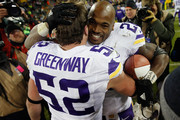 Chad Greenway #52 of the Minnesota Vikings and Adrian Peterson #28 react after their game against the Green Bay Packers at Lambeau Field on January 3, 2016 in Green Bay, Wisconsin. The Minnesota Vikings defeated the Green Bay Packers with a score of 20 to 13.