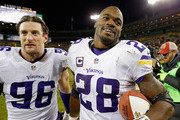 Brian Robison #96 of the Minnesota Vikings and Adrian Peterson #28 react after their game against the Green Bay Packers at Lambeau Field on January 3, 2016 in Green Bay, Wisconsin. The Minnesota Vikings defeated the Green Bay Packers with a score of 20 to 13.