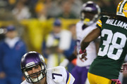 Quarterback Christian Ponder #7 of the Minnesota Vikings gets up off the turf after being sacked by the Green Bay Packers in the first half of the NFL game on October 02, 2014 at Lambeau Field in Green Bay, Wisconsin.