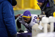 Adrian Peterson #28 of the Minnesota Vikings is attended to by training staff on the sideline during the third quarter against the Green Bay Packers at Lambeau Field on January 3, 2016 in Green Bay, Wisconsin.