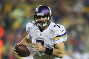 Quarterback Christian Ponder #7 of the Minnesota Vikings runs the ball into the end zone for a touchdown during the third quarter of their game against the Green Bay Packers on October 02, 2014 at Lambeau Field in Green Bay, Wisconsin. The Packers defeated the Vikings 42-10.