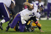 Christian Ponder #7 of the Minnesota Vikings is sacked by Letroy Guion #98 of the Green Bay Packers during the fourth quarter on October 02, 2014 at Lambeau Field in Green Bay, Wisconsin. The Packers defeated the Vikings 42-10.