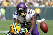 Mackensie Alexander #20 of the Minnesota Vikings breaks up a pass intended for Randall Cobb #18 of the Green Bay Packers during the second quarter of a game at Lambeau Field on September 16, 2018 in Green Bay, Wisconsin.