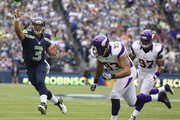 Everson Griffen and Russell Wilson Photos Photo