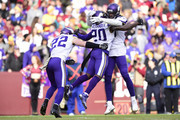 Cornerback Mackensie Alexander #20 of the Minnesota Vikings celebrates with Harrison Smith #22 and Emmanuel Lamur #59 after an interception during the second quarter against the Washington Redskins at FedExField on November 12, 2017 in Landover, Maryland.