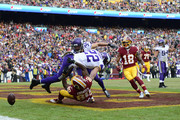 Wide receiver Jamison Crowder #80 of the Washington Redskins attempts to pull in a catch as he is tackled by free safety Harrison Smith #22 of the Minnesota Vikings during the third quarter at FedExField on November 12, 2017 in Landover, Maryland.