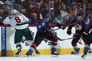 Cody McCormick #8 of the Minnesota Wild and Jan Hejda #8 of the Colorado Avalanche battle for control of the puck in Game Five of the First Round of the 2014 NHL Stanley Cup Playoffs at Pepsi Center on April 26, 2014 in Denver, Colorado.