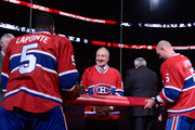P.K. Subban #76 and Andrei Markov #79 hang the banner that will be raised to the Bell Centre rafters during the jersey retirement ceremony for former Montreal Canadiens player Guy Lapointe prior to the NHL game between the Montreal Canadiens and the Minnesota Wild at the Bell Centre on November 8, 2014 in Montreal, Quebec, Canada.