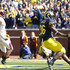 Kevin Koger Denard Robinson Photos - Kevin Koger #86 of the Michigan Wolverines scores on an 18-yard touchdown pass from teammate Denard Robinson #16 during the second quarter of the game against the Minnesota Golden Gophers at Michigan Stadium on October 1, 2011 in Ann Arbor, Michigan. - Minnesota v Michigan