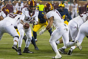 Demry Croft #11 of the Minnesota Golden Gophers hands the football off to Rodney Smith #1 during a college football game against the Michigan Wolverines at Michigan Stadium on November 4, 2017 in Ann Arbor, Michigan.