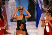 Miss Venezuela Ivian Sarcos is crowned Miss World 2011 by Miss World 2010, Alexandria Mills (rear) in the Miss world 2011 World Final on November 6, 2011 in London, England.