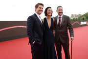 (L-R) Tom Cruise, a guest and Jake Myers attend the Global Premiere of 'Mission: Impossible - Fallout' at Palais de Chaillot on July 12, 2018 in Paris, France.