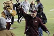 Head coach Dan Mullen of the Mississippi State Bulldogs waves to the crowd as he walks off the field after the game against the Texas A&M Aggies at Kyle Field on October 28, 2017 in College Station, Texas.