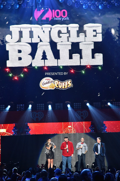 Z100's Jingle Ball Show [stage,product,performance,talent show,fan,event,crowd,font,music,concert,radio personalities,elvis duran,jj kincaid,l-r,shelley rome,z100,iheartradio,jingle ball 2014,goldfish puffs - show,mo bounce]