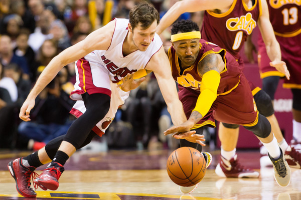 Miami Heat v Cleveland Cavaliers [player,basketball,sports,basketball moves,basketball player,tournament,team sport,ball game,sport venue,goran dragic 7,user,mo williams,note,heat,ball,cleveland,cleveland cavaliers,miami heat,half]