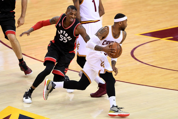 Toronto Raptors v Cleveland Cavaliers - Game One [photograph,basketball,sports,team sport,ball game,basketball player,player,tournament,sports equipment,sport venue,game one,delon wright,user,mo williams,note,cleveland,toronto raptors,cleveland cavaliers,game]