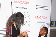 Gina Belafonte (L) and Maxwell attend the MoCADA 3rd Annual Masquerade Ball at Brooklyn Academy of Music on October 25, 2017 in New York City.