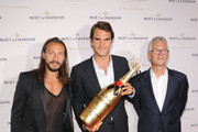 (L-R) DJ Bob Sinclar, Professional Tennis Player Roger Federer, and Moet & Chandon CEO Stephane Baschiera attend Moet & Chandon Celebrates Its 270th Anniversary With New Global Brand Ambassador, International Tennis Champion, Roger Federer at Chelsea Piers Sports Center on August 20, 2013 in New York City.