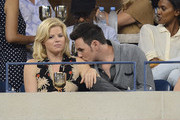 Actress Megan Hilty (L) and Brian Gallagher attend the Moet & Chandon Suite at USTA Billie Jean King National Tennis Center on August 30, 2013 in New York City.