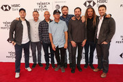 """(L-R) Jeff Zimbalist, Michael Zimbalist, Taylor Knox, Kelly Slater, Shane Dorian,  Benji Weatherly, Taylor Steele, Rob Machado and Michael Zimbalist attend a screening for """"Momentum Generation"""" during te 2018 Tribeca Film Festival at SVA Theatre on April 21, 2018 in New York City."""