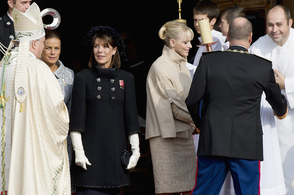 (L-R)  Princess Stephanie of Monaco, Princess Caroline of Hanover, Princess Charlene of Monaco and Prince Albert II of Monaco  leave the Cathedral Notre Dame after a mass during the celebrations marking Monaco's National Day on November 19, 2011 in Monaco, Monaco.
