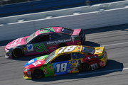 Kyle Busch, driver of the #18 M&M's Toyota, races Ryan Newman, driver of the #31 Liberty National Chevrolet, during the Monster Energy NASCAR Cup Series 1000Bulbs.com 500 at Talladega Superspeedway on October 14, 2018 in Talladega, Alabama.