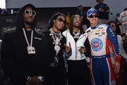 Joey Logano, driver of the #22 AAA Southern California Ford, meets Migos prior to the Monster Energy NASCAR Cup Series Auto Club 400 at Auto Club Speedway on March 18, 2018 in Fontana, California.