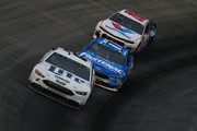 Brad Keselowski, driver of the #2 Miller Lite Ford, leads Ricky Stenhouse Jr., driver of the #17 Fastenal Ford, and Alex Bowman, driver of the #88 Valvoline Chevrolet, during the Monster Energy NASCAR Cup Series Bass Pro Shops NRA Night Race at Bristol Motor Speedway on August 18, 2018 in Bristol, Tennessee.