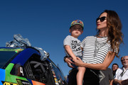 Wife of Kyle Busch, driver of the #18 M&M's Caramel Toyota, Samantha Busch and their son Brexton take part in pre-race ceremonies for the Monster Energy NASCAR Cup Series Championship Ford EcoBoost 400 at Homestead-Miami Speedway on November 19, 2017 in Homestead, Florida.