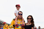 Kyle Busch, driver of the #18 M&M's Red White & Blue Toyota, poses his wife, Samantha, and son, Brexton, prior to the start of the Monster Energy NASCAR Cup Series Coca-Cola 600 at Charlotte Motor Speedway on May 27, 2018 in Charlotte, North Carolina.