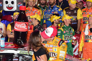 Kyle Busch, driver of the #18 M&M's Red White & Blue Toyota, celebrates in victory lane with his wife, Samantha, and son, Brexton, after winning the Monster Energy NASCAR Cup Series Coca-Cola 600 at Charlotte Motor Speedway on May 27, 2018 in Charlotte, North Carolina.