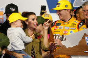 Kyle Busch, driver of the #18 M&M's Toyota, celebrates in Victory Lane with wife Samantha and son Brexton after winning the Monster Energy NASCAR Cup Series Federated Auto Parts 400 at Richmond Raceway on September 22, 2018 in Richmond, Virginia.