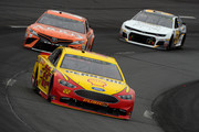 Joey Logano, driver of the #22 Shell Pennzoil Ford, leads Daniel Suarez, driver of the #19 ARRIS Toyota, and Ryan Newman, driver of the #31 Chevrolet Accessories Chevrolet, during the Monster Energy NASCAR Cup Series Foxwoods Resort Casino 301 at New Hampshire Motor Speedway on July 22, 2018 in Loudon, New Hampshire.