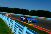 Kyle Larson, driver of the #42 Credit One Bank/DC Solar Chevrolet, leads Clint Bowyer, driver of the #14 Rush Truck Centers Ford, during the Monster Energy NASCAR Cup Series GoBowling at The Glen at Watkins Glen International on August 5, 2018 in Watkins Glen, New York.
