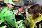 Kyle Busch, driver of the #18 Interstate Batteries Toyota, affixes the winner's decal to his car in Victory Lane with his son Brexton and wife Samantha after winning the Monster Energy NASCAR Cup Series O'Reilly Auto Parts 500 at Texas Motor Speedway on April 8, 2018 in Fort Worth, Texas.