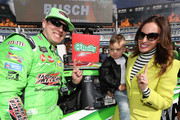 Kyle Busch, driver of the #18 Interstate Batteries Toyota, poses with the winner's decal in Victory Lane with his son Brexton and wife Samantha after winning the Monster Energy NASCAR Cup Series O'Reilly Auto Parts 500 at Texas Motor Speedway on April 8, 2018 in Fort Worth, Texas.