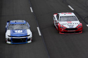 Alex Bowman, driver of the #88 Nationwide Chevrolet, leads Brad Keselowski, driver of the #2 Wurth Ford, during the Monster Energy NASCAR Cup Series Pocono 400 at Pocono Raceway on June 3, 2018 in Long Pond, Pennsylvania.