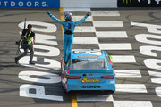 Kyle Busch, driver of the #18 M&M's Hazelnut Toyota, celebrates winning the Monster Energy NASCAR Cup Series Pocono 400 at Pocono Raceway on June 02, 2019 in Long Pond, Pennsylvania.